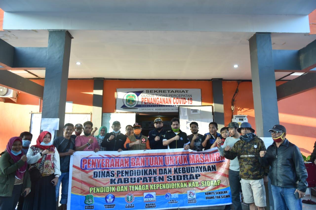 Kegiatan Karang Taruna bersama Pemkab Sidrap Distribusikan Kontribusi ke Masamba untuk korban musibah alam banjir besar, Sulawesi Selatan.